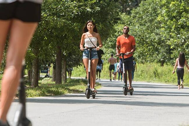 Students on scooters in Atlanta