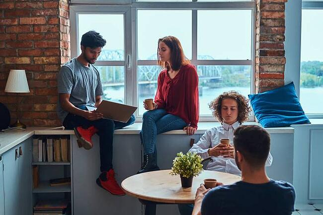 Students chatting in shared apartment