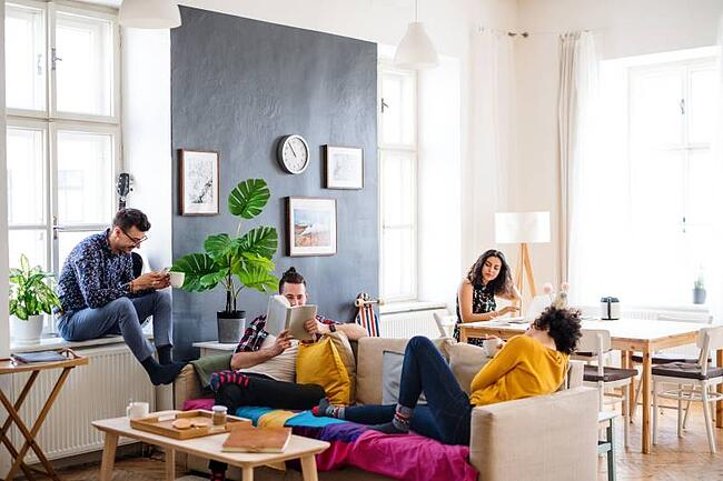 students studying in their shared apartment