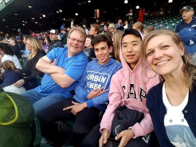 Host family at baseball game