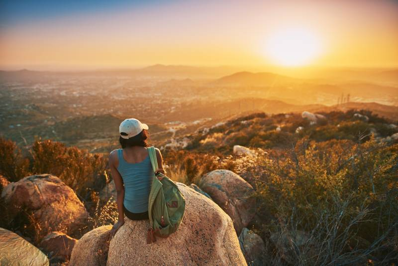 Student Sitting on a rock overlooking San Diego
