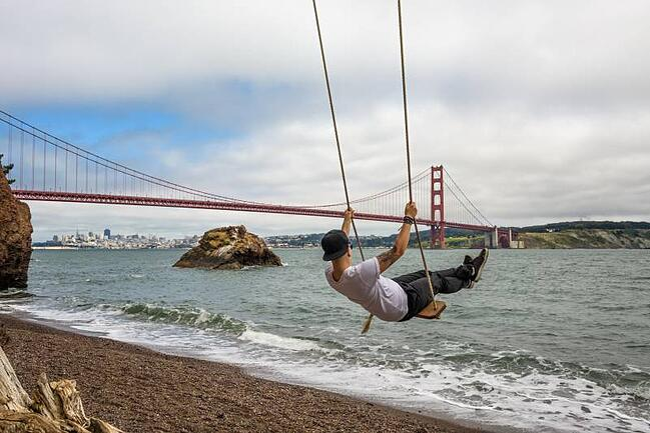 Student Swinging Near Golden Gate Bridge