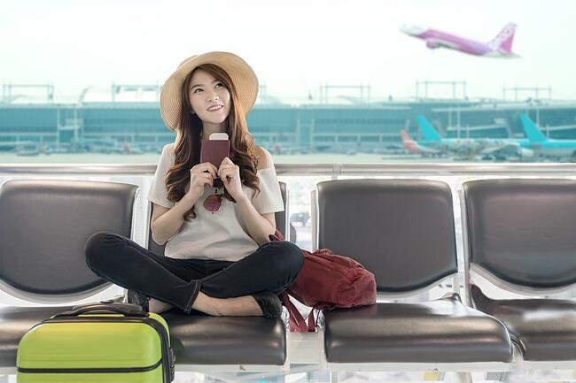 Student waiting for her flight at the airport