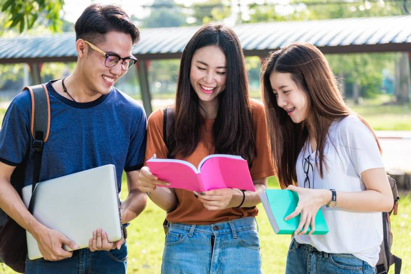 Three exchange students outside together