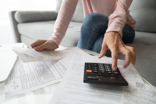 student reviewing her bills